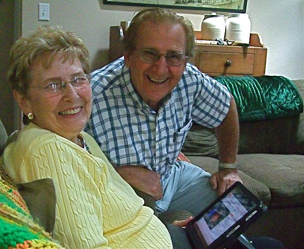 Smiling Couple with iPad