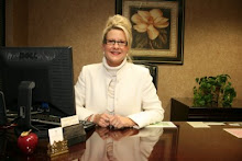 Denise Price Thomas at her Desk